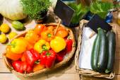 Vegetables in baskets with nameplates at market — Stock Photo