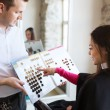 Woman choosing hair color from palette at salon — Stock Photo #73568053