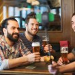 Friends taking selfie and drinking beer at bar — Stock Photo #73568507