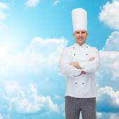 Happy male chef cook with crossed hands — Stockfoto