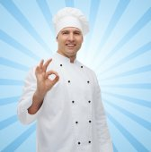 Happy male chef cook showing ok sign — Stock Photo