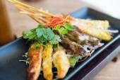Close up of deep-fried asian snacks on plate — Stock Photo