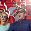 Friends watching horror movie in 3d theater — Stock Photo #73764531