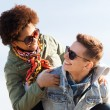 Happy teenage couple in shades having fun outdoors — Stock Photo #73765131