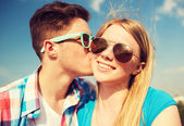 Smiling couple outdoors — Stock Photo
