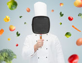 Male chef cook covering face with grill pan — Fotografia Stock