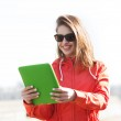 Happy young woman or teenage girl with tablet pc — 图库照片 #74106611