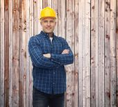 Smiling male builder or manual worker in helmet — Fotografia Stock