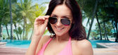 Happy woman in sunglasses and swimsuit — Fotografia Stock