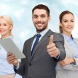 Group of smiling businessmen showing thumbs up — Stock Photo #74314699