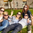 Group of happy students showing victory gesture — Stock Photo #74319293