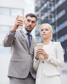 Serious businessmen with paper cups outdoors — Stock Photo