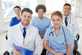 Group of happy doctors on seminar at hospital — Stock Photo