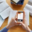 Students with smartphones making cheat sheets — Stock Photo #74723843