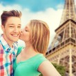 Happy couple taking selfie over eiffel tower — Stock Photo #75201543