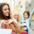 Beautiful woman with shopping bags in the ctiy — Stock Photo #75203091