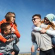 Happy friends in shades having fun outdoors — Stock Photo #75204137