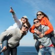 Happy friends in shades having fun outdoors — Stock Photo #75204163