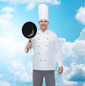 Happy male chef cook holding frying pan — Foto Stock