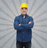 Smiling male builder or manual worker in helmet — Foto de Stock