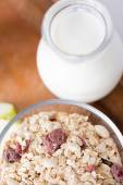 Close up of bowl with granola or muesli on table — Stock Photo