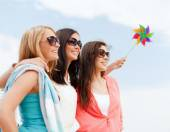 Girls with windmill toy on the beach — Stock Photo
