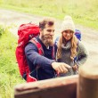 Smiling couple with backpacks hiking — Stock Photo #75718699