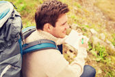 Smiling man with backpack hiking — Stock Photo