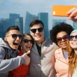 Smiling friends taking selfie with smartphone — Stock Photo #75806997