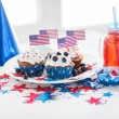 Cupcakes with american flags on independence day — Stock Photo #76031837