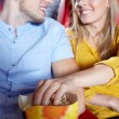 Happy couple watching movie in theater or cinema — Stock Photo #76031849