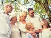 Happy family in front of house outdoors — Stock Photo