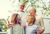Happy family in front of house outdoors — Stockfoto