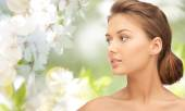 Beautiful young woman face looking aside — Stock Photo