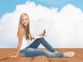 Happy student girl with laptop computer — Stock Photo