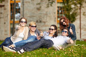 Group of students or teenagers showing thumbs up — Stock Photo