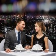 Smiling couple looking at each other at restaurant — Stock Photo #76845597