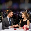 Man proposing to his girlfriend at restaurant — Stock Photo #76845833