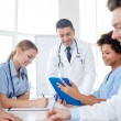 Group of happy doctors meeting at hospital office — Stock Photo #76847477