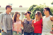 Group of smiling friends outdoors — Stock Photo