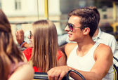 Smiling couple traveling by tour bus — Stock Photo
