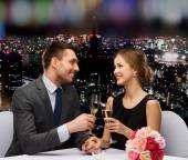 Couple with glasses of champagne at restaurant — Stock Photo