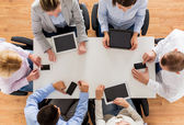 Business team with smartphones and tablet pc — Stock Photo