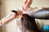 close up of stylist making hairdo at salon — Stock Photo
