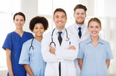 Group of happy doctors at hospital — Stock Photo