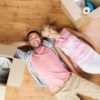 Couple with big cardboard boxes moving to new home — Stock Photo #77043259
