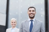 Close up of smiling businessmen — Stock Photo
