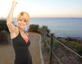 Happy woman jogging outdoors over beach background — Stock Photo