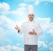 Happy male chef cook inviting — Stock Photo