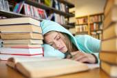 Student or woman with books sleeping in library — Stock Photo